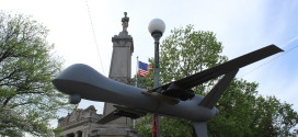 A replica MQ-9 Reaper drone is displayed outside the Monroe County Courthouse as part of today's demonstration.